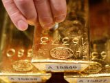 Gold trades marginally lower, awaiting trade talk cues