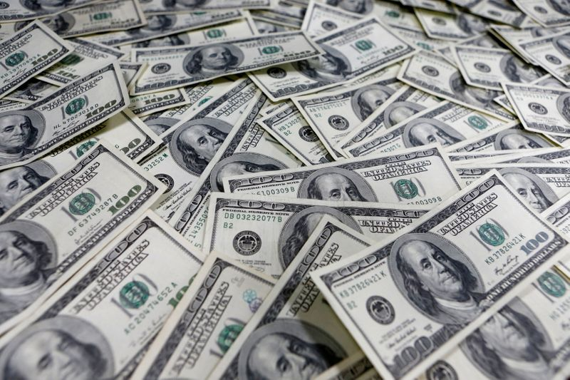 Dollar under pressure as economic uncertainties linger